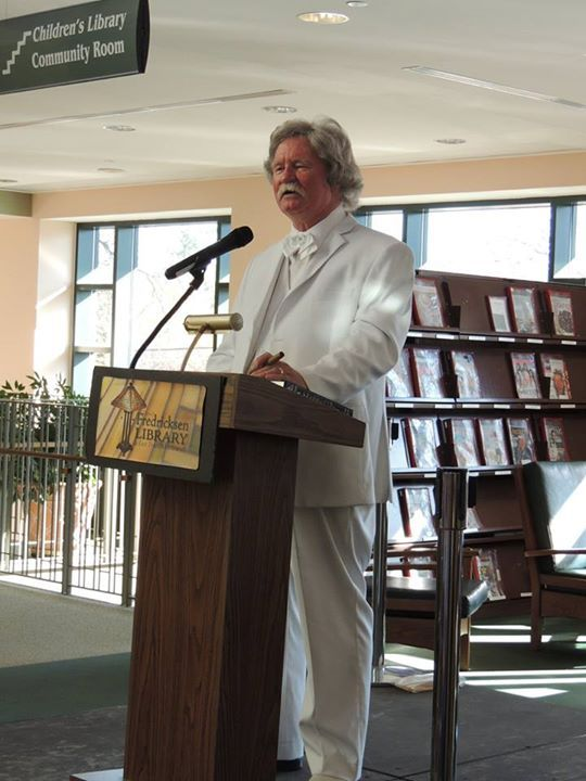 Mark Twain Actor Speaking in a Library